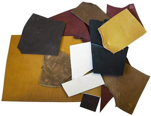 ASSORTED LEATHER STRIPS AND LARGER PIECES IN ASSORTED COLORS
